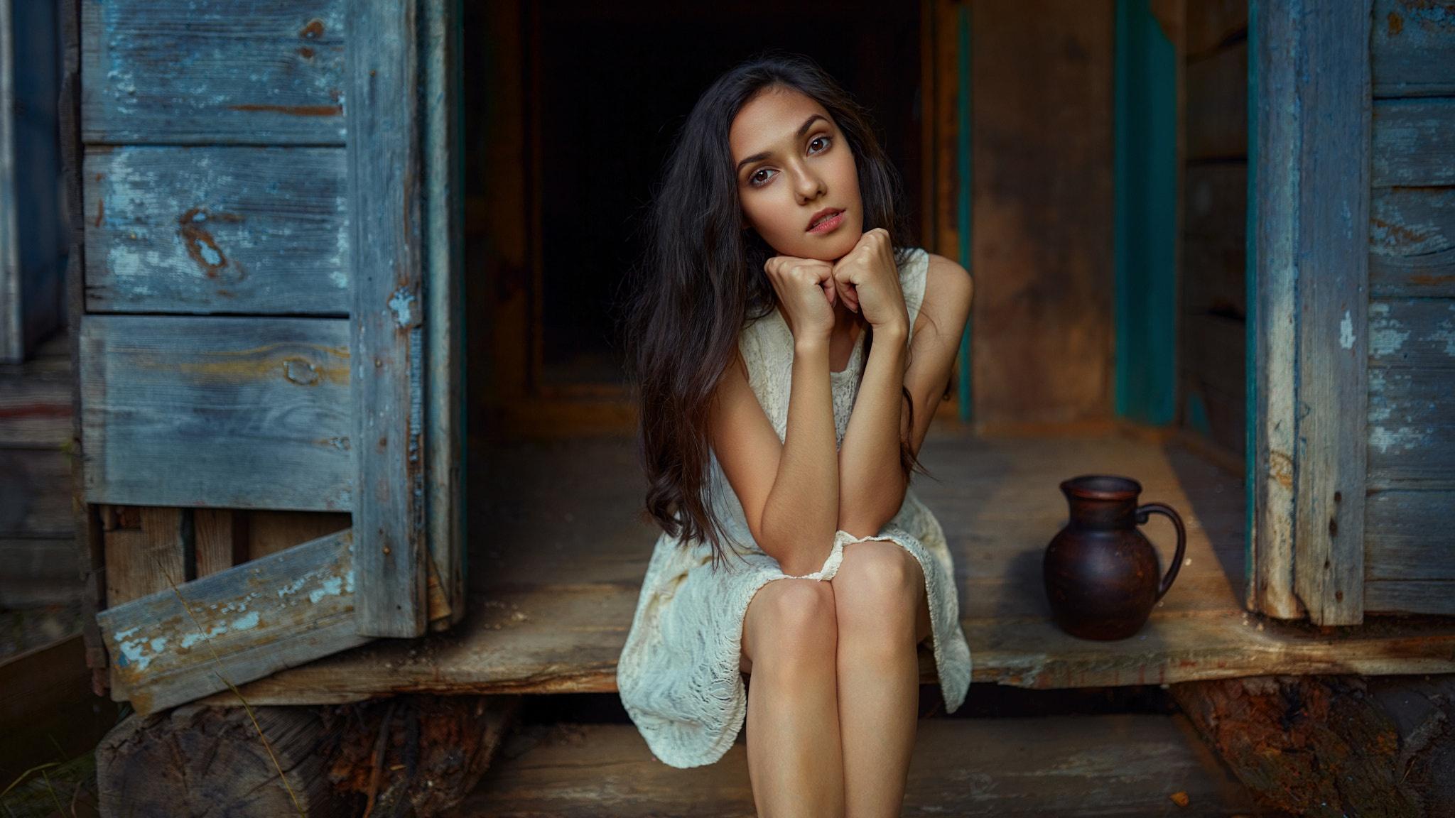 Andrey Metelkov Model Women Brunette Brown Eyes Dress Bare Shoulders Legs Sitting Touching Face Long 2048x1152