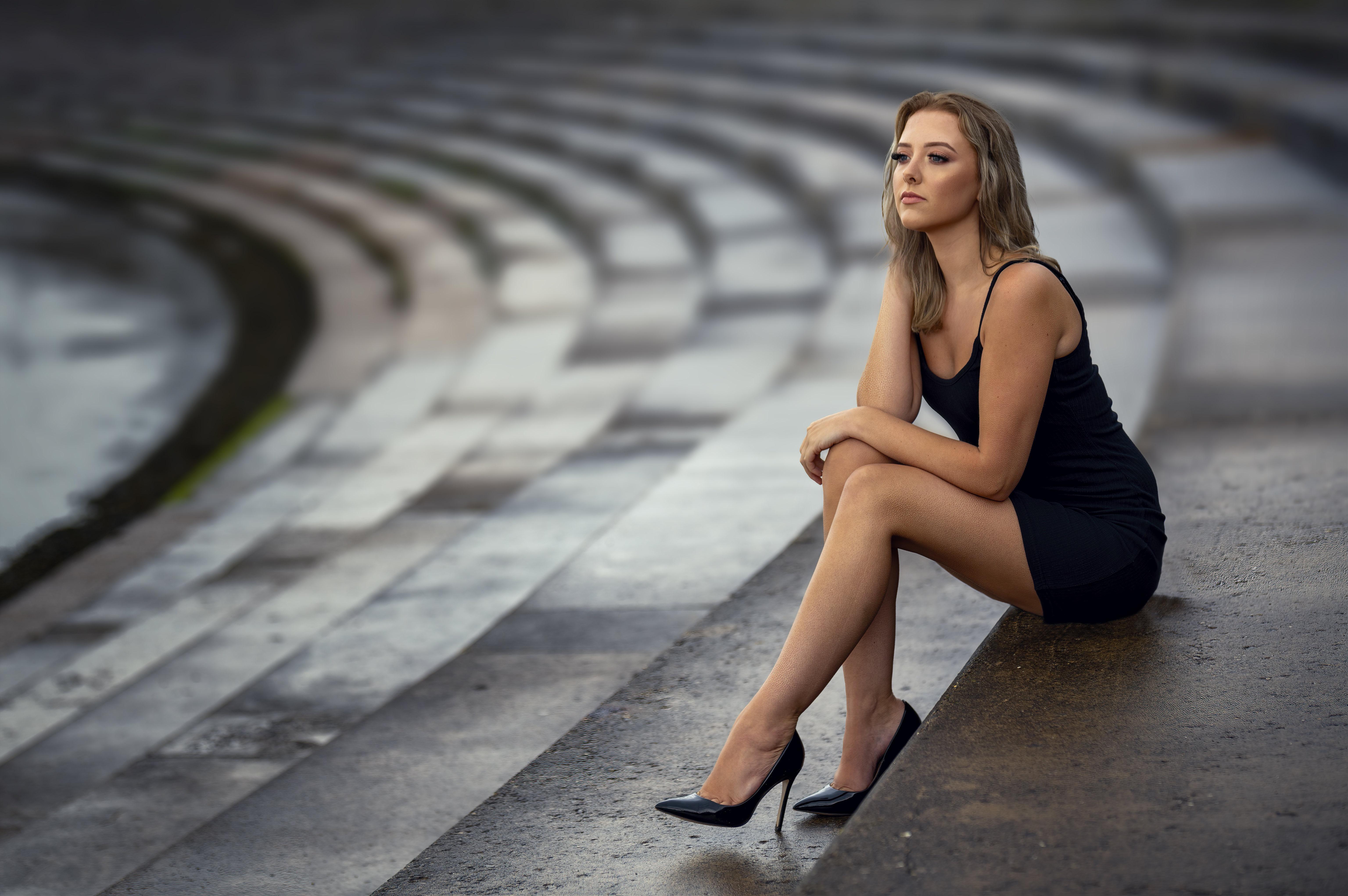 Alex Siracusano Model Women Blonde Dark Eyes Dress Black Dress Legs High Heels Sitting Looking Away  6144x4084